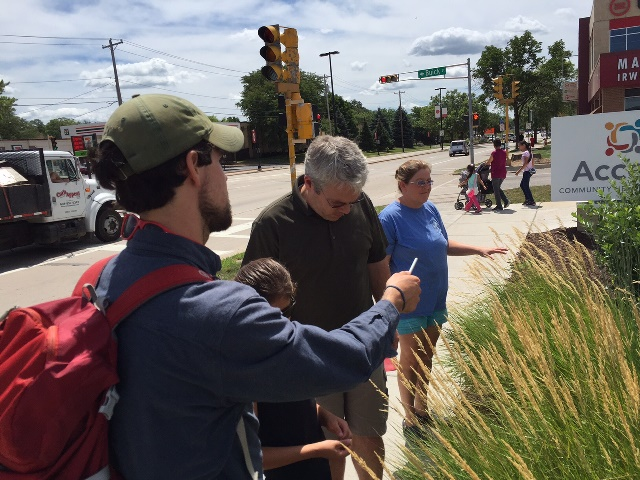 Tom Pearce, Great Neighborhoods Program Director, leads the walk.