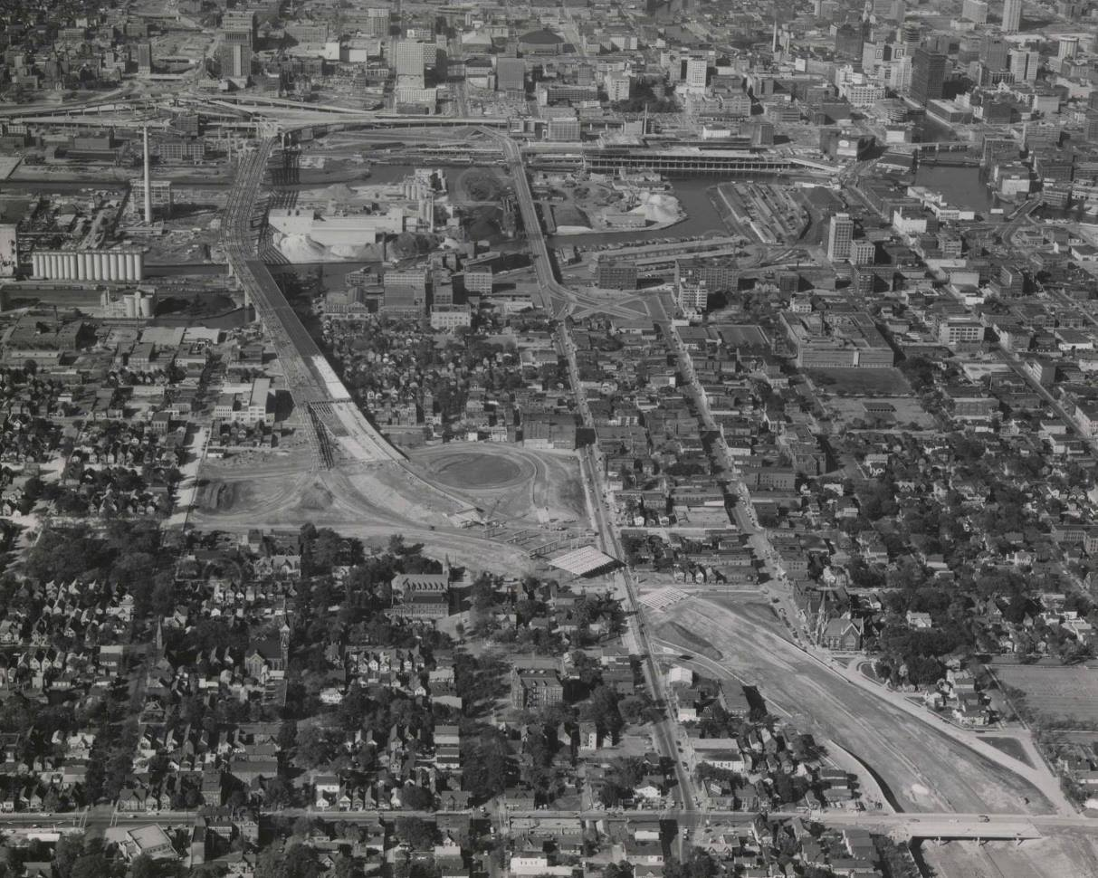 Walker's point looking North - Subtitle: Walker's Point neighborhood looking North to the Marquette Interchange. Photo courtesy of the Milwaukee County Historical Society